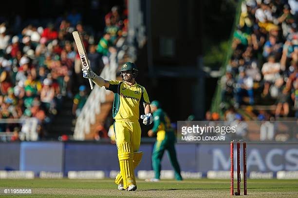 Australia's batsman Travis Head celebrates his maiden half century during the One Day International match between South Africa and Australia at...