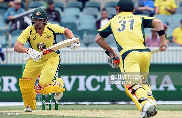 Australia's batsmen Aaron Finch and David Warner runs between the wickets during the second game of the One Day International Cricket series between...