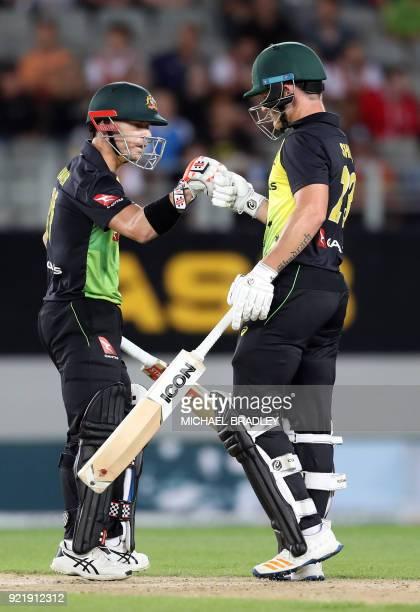Australia's batsmen David Warner and D'Arcy Short touch gloves during the final Twenty20 Tri Series international cricket match between New Zealand...