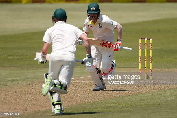 Australia's batsmen David Warner and Steven Smith run during day one of the first Sunfoil Test between South Africa and Australia at Kingsmead...