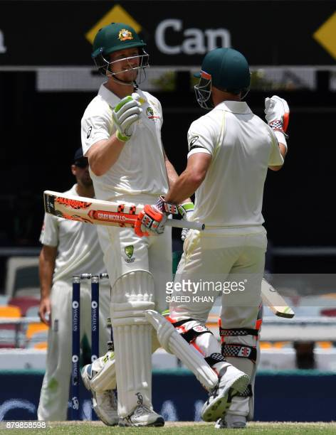 Australia's batsmen Davis Warner and Cameron Bancroft celebrate their team's victory of the first cricket Ashes Test between England and Australia in...