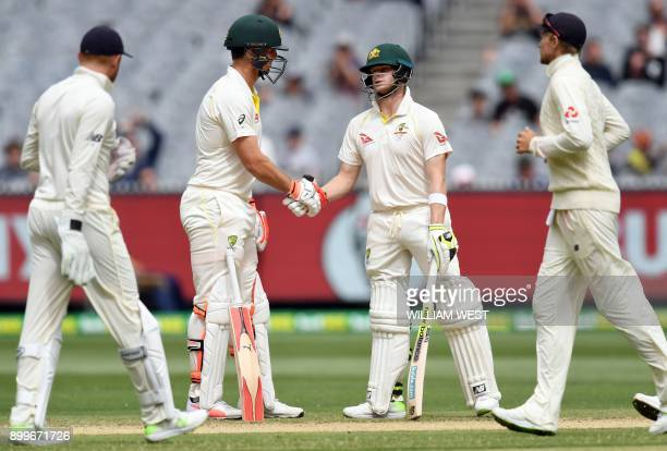 Australia's batsmen Mitchell Marsh and Steve Smith shake hands after their 100run partnership against England on the final day of the fourth Ashes...