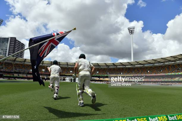Australia's batting pair Cameron Bancroft and David Warner enter the ground for the final day's play of the first cricket Ashes Test between England...