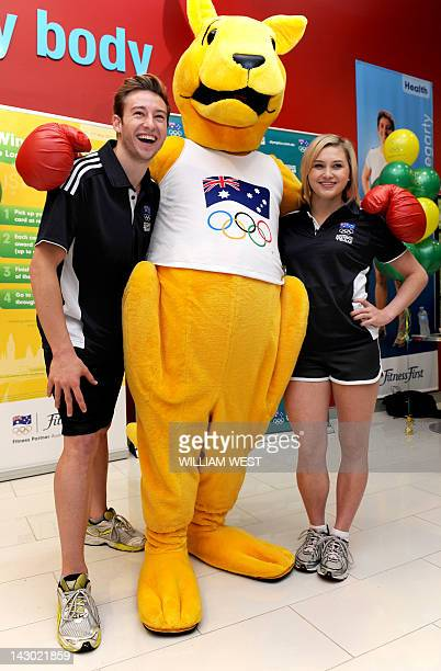 Australia's Beijing 2008 Olympic diving gold medallist Matt Mitcham and silver medallist Melissa Wu pose with the Boxing Kangaroo as the Australian...