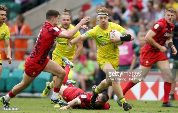 Australia's Ben O'Donnell and Wales's Owen Jenkins during day one of the HSBC London Sevens at Twickenham Stadium London