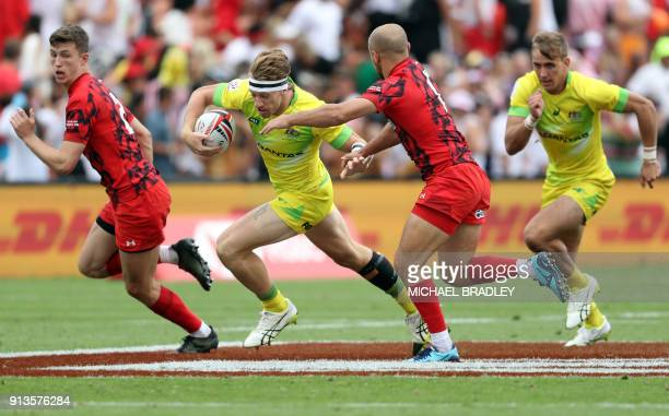 Australia's Ben O'Donnell tries to evade a tackle during the World Rugby Sevens Series match between Australia and Wales at Waikato Stadium in...