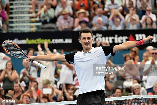 Australia's Bernard Tomic celebrates his victory against Japan's Kei Nishikori in their men's singles quarterfinal match on the sixth day of the...