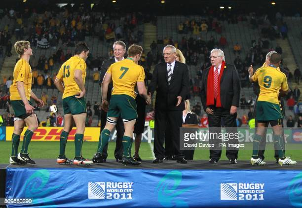 Australia's Berrick Barnes Adam AshleyCooper DAvid Pocock and Will Genia shake hands with IRB Chairman Bernard Lapasset after winning the Bronze Final