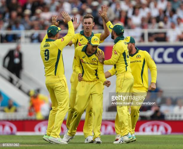 Australia's Billy Stanlake celebrates with his team mates after taking the wicket of England's Joe Root during the Royal London 1st ODI match between...
