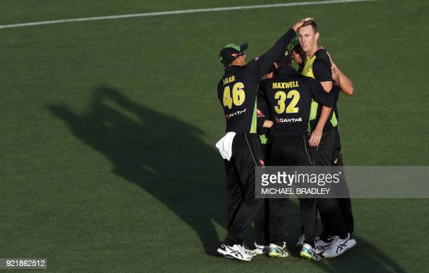 Australia's Billy Stanlake celebrates with teammates after taking the wicket of New Zealand's Martin Guptill during the final Twenty20 Tri Series...
