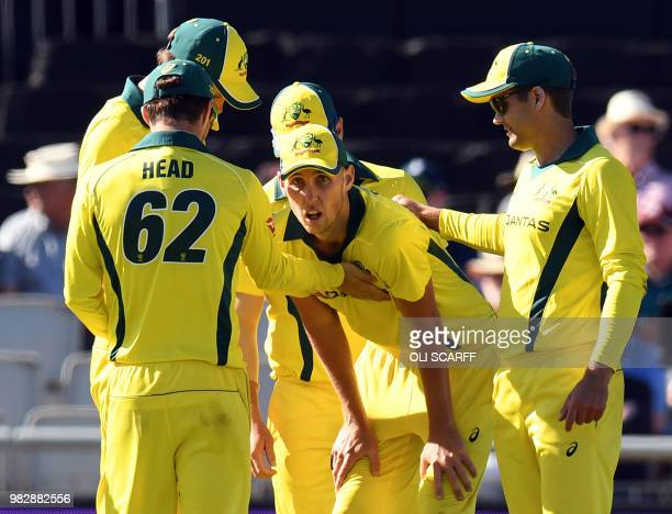 Australia's Billy Stanlake celebrates with teammates after taking the catch to dismiss England's Adil Rashid for 20 during the fifth One Day...