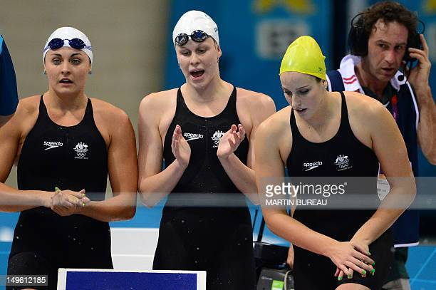 Australia's Blair Evans Jade Neilsen Angie Bainbridge applaud after the women's 4x200m freestyle relay heats swimming event at the London 2012...