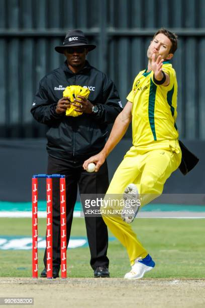 Australia's bowler Andrew Tye delivers the ball past umpire Jeremiah Matibiri during the sixth T20 cricket match between Australia and host nation...