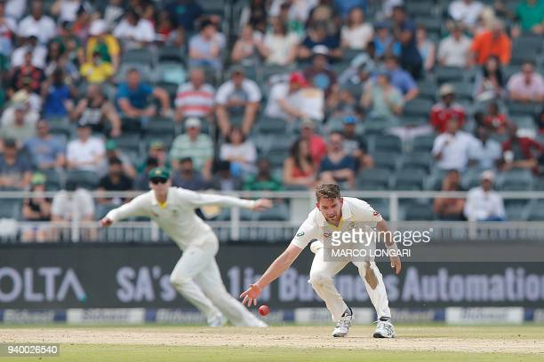Australia's bowler Chadd Sayers catches his own delivery during day one of the fourth Sunfoil Test between South Africa and Australia at Wanderers...