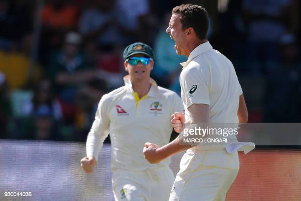 Australia's bowler Josh Hazlewood celebrates taking the wicket of South Africa's batsman Dean Elgar during day two of the second Sunfoil Cricket Test...