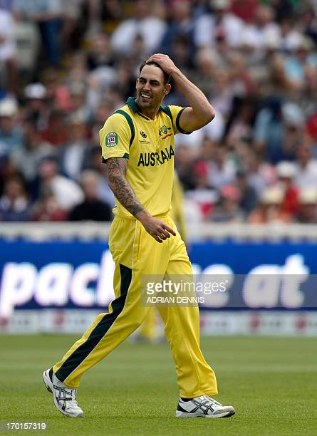 Australia's bowler Mitchell Johnson looks on during the 2013 ICC Champions Trophy cricket match between England and Australia at Edgbaston in...