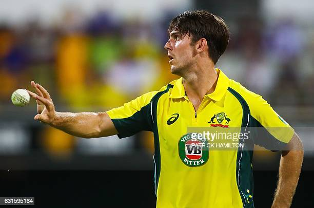 Australia's bowler Mitchell Marsh catches the ball during the oneday international cricket match between Pakistan and Australia in Brisbane on...