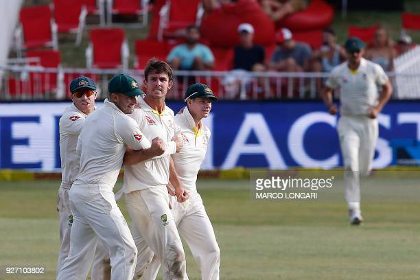 Australia's bowler Mitchell Marsh celebrates taking the wicket of South Africa's batsman Aiden Markram during the fourth day of the first Test...