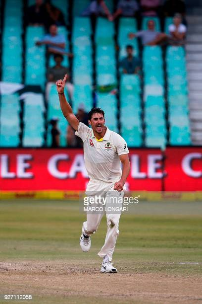 Australia's bowler Mitchell Starc celebrates taking the wicket of South Africa's batsman Keshav Maharaj during the fourth day of the first Test...