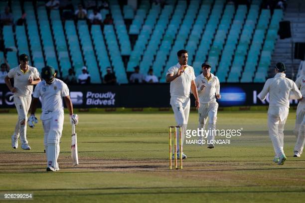 Australia's bowler Mitchell Starc celebrates the wicket of Vernon Philander during day two of the first Sunfoil Test between South Africa and...