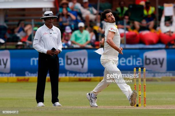 Australia's bowler Mitchell Starc delivers the ball during day two of the second Sunfoil Test between South Africa and Australia at St Georges Park...
