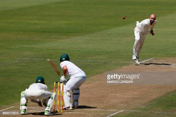 Australia's bowler Nathan Lyon delivers the ball to South Africa batsman Dean Elgar during day two of the second Sunfoil crickekt Test match between...