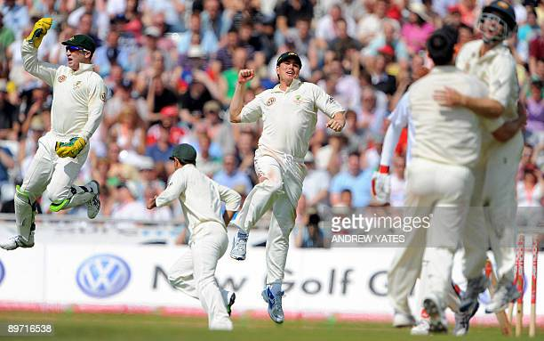 Australia's Brad Haddin and Marcus North celebrate after Mitchell Johnson had taken the last England wicket to win the teat during the third day of...