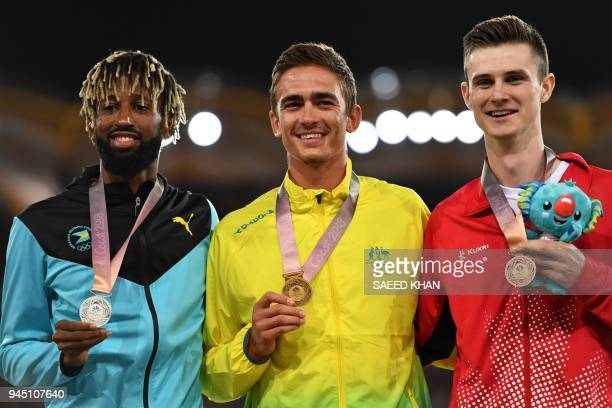 Australia's Brandon Starc Bahamas' Jamal Wilson and Canada's Django Lovett pose with thier medal a day after the athletics men's hig jum during the...