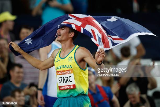 Australia's Brandon Starc holds his national flag after winning the athletics men's high jump final during the 2018 Gold Coast Commonwealth Games at...