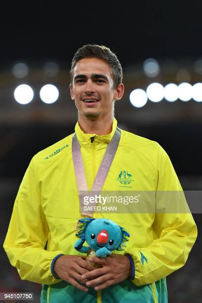 Australia's Brandon Starc poses with his medal a day after the athletics men's hig jum during the 2018 Gold Coast Commonwealth Games at the Carrara...