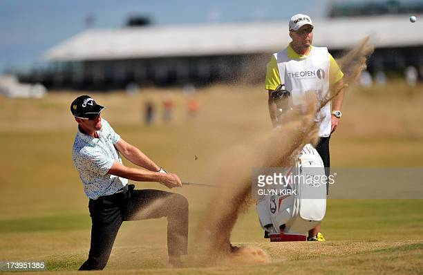 Australia's Brendan Jones plays out of a bunker onto the 16th green during the first round of the 2013 British Open Golf Championship at Muirfield...