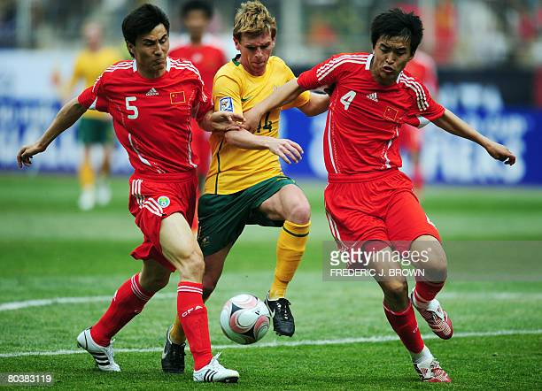 Australia's Brett Holman vies for the ball with China's Li Weifang and Feng Xiaoting during their 2010 World Cup qualifier match on March 26, 2008 in...