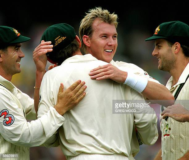 Australia's Brett Lee congratulates Adam Gilchrist watched by Justin langer and Simon Katich after the pair had combined to dismiss Graeme Smith of...