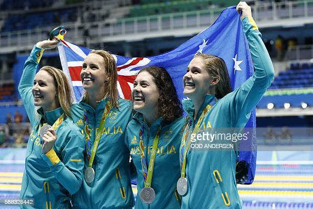 Australia's Bronte Barratt Australia's Emma Mckeon Australia's Tamsin Cook and Australia's Leah Neale pose with their silver medal during the medal...