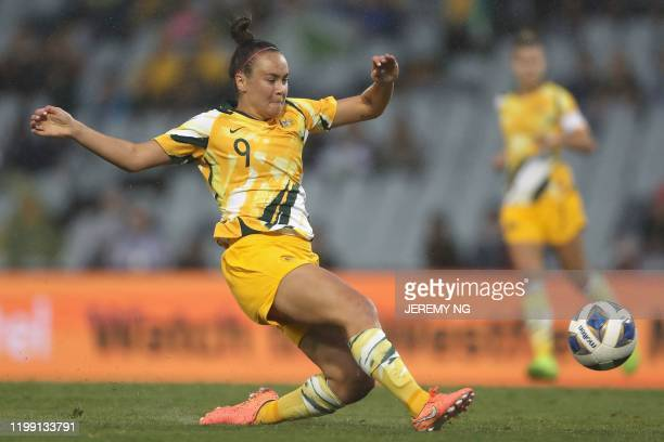 Australias Caitlin Foord shoots and scores a goal during the women's Olympic football tournament qualifier match between Taiwan and Australia at...