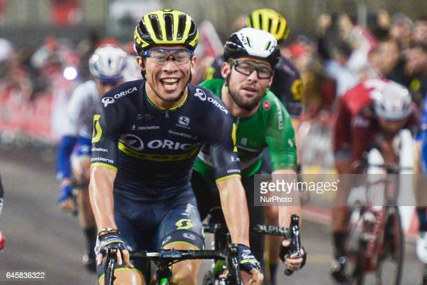 Australia's Caleb EWAN from OricaScott and UK's Mark CAVENDISH from Dimention Data at the finish line of the fourth stage a 143km Yas Island Stage at...