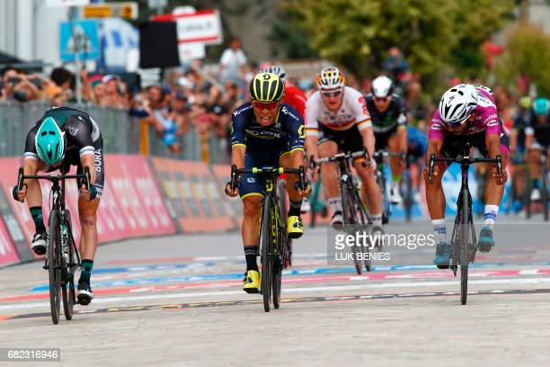 Australia's Caleb Ewan of the Orica team sprints to win ahead Colombia's Fernando Gaviria of team QuickStep and Ireland's Sam Bennett of team Bora...