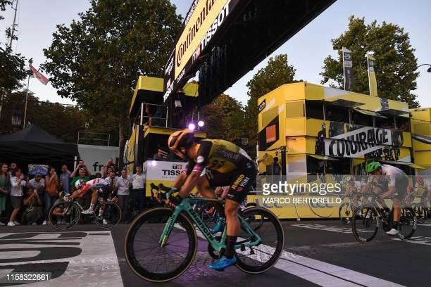 Australia's Caleb Ewan sprints wtih Netherlands' Dylan Groenewegen to win on the finish line of the 21st and last stage of the 106th edition of the...