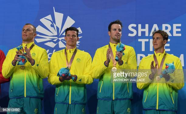 Australia's Cameron Mcevoy James Magnussen Jack Cartwright and Kyle Chalmers pose with their medals after the swimming men's 4x100m freestyle relay...