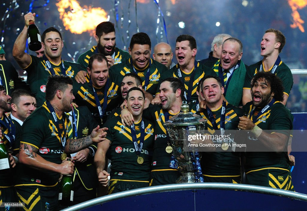 Australia's Cameron Smith and Billy Slater (centre) celebrate their victory with team-mates in the Rugby League World Cup Final at Old Trafford, Manchester.