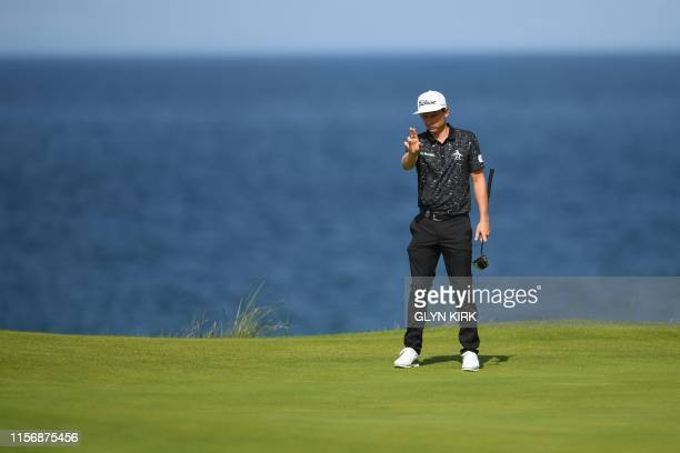 Australia's Cameron Smith prepares to putt at the 5th green during the third round of the British Open golf Championships at Royal Portrush golf club...