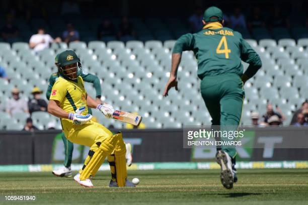 Australia's captain Aaron Finch decides not to run as South Africa's fieldsman Aiden Markram fields the ball during the second one day international...
