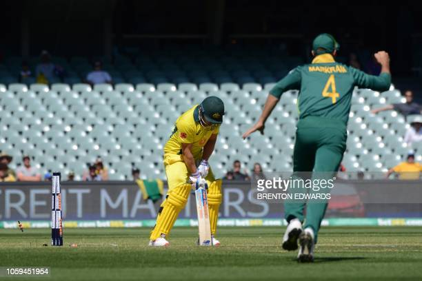 Australia's captain Aaron Finch is out as South Africa's fieldsman Aiden Markram celebrates during the second one day international cricket match...