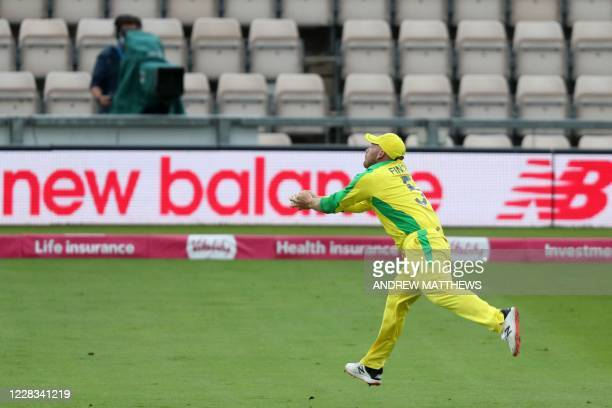 Australia's Captain Aaron Finch runs to make a catch to take the wicket of England's Tom Banton during the international Twenty20 cricket match...