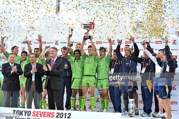 Australia's captain Ed Jenkins and teammates celebrate their victory during an awarding ceremony of the 2012 Tokyo Sevens World Series rugby...