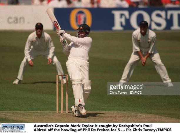 Australia's Captain Mark Taylor is caught by Derbyshire's Paul Aldred off the bowling of Phil De Freitas for 5