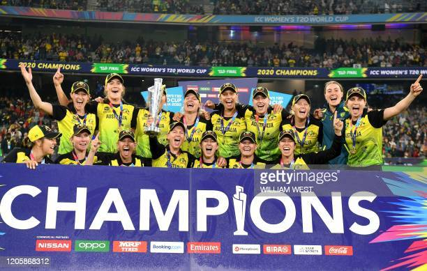 Australia's captain Meg Lanning with teammates celebrate with the winning trophy of Twenty20 women's cricket World Cup after beating India in the...