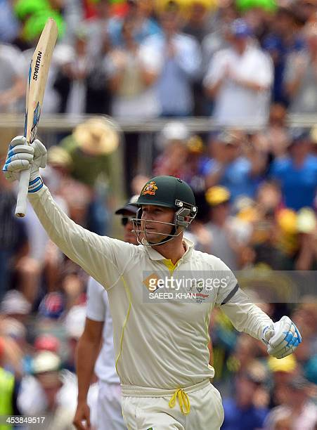 Australia's captain Michael Clarke celebrates scoring his century against England during day two of the second Ashes Test cricket match in Adelaide...