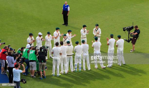Australia's captain Michael Clarke is given a guard of honour by his teammates as he walks off following the match