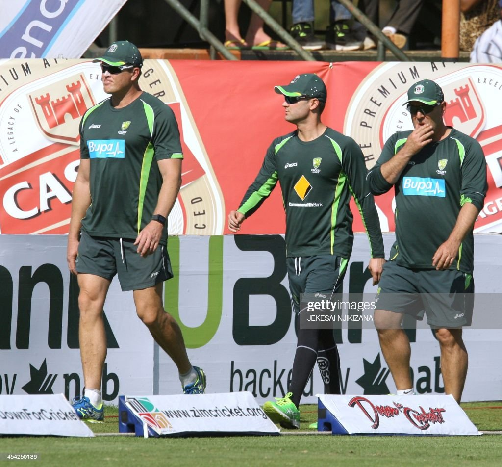 Australia's captain Michael Clarke (C) walks around the field of play during a cricket match between Australia and South Africa, part of a one day international tri-series at the Harare Sports Club, on August 27, 2014.